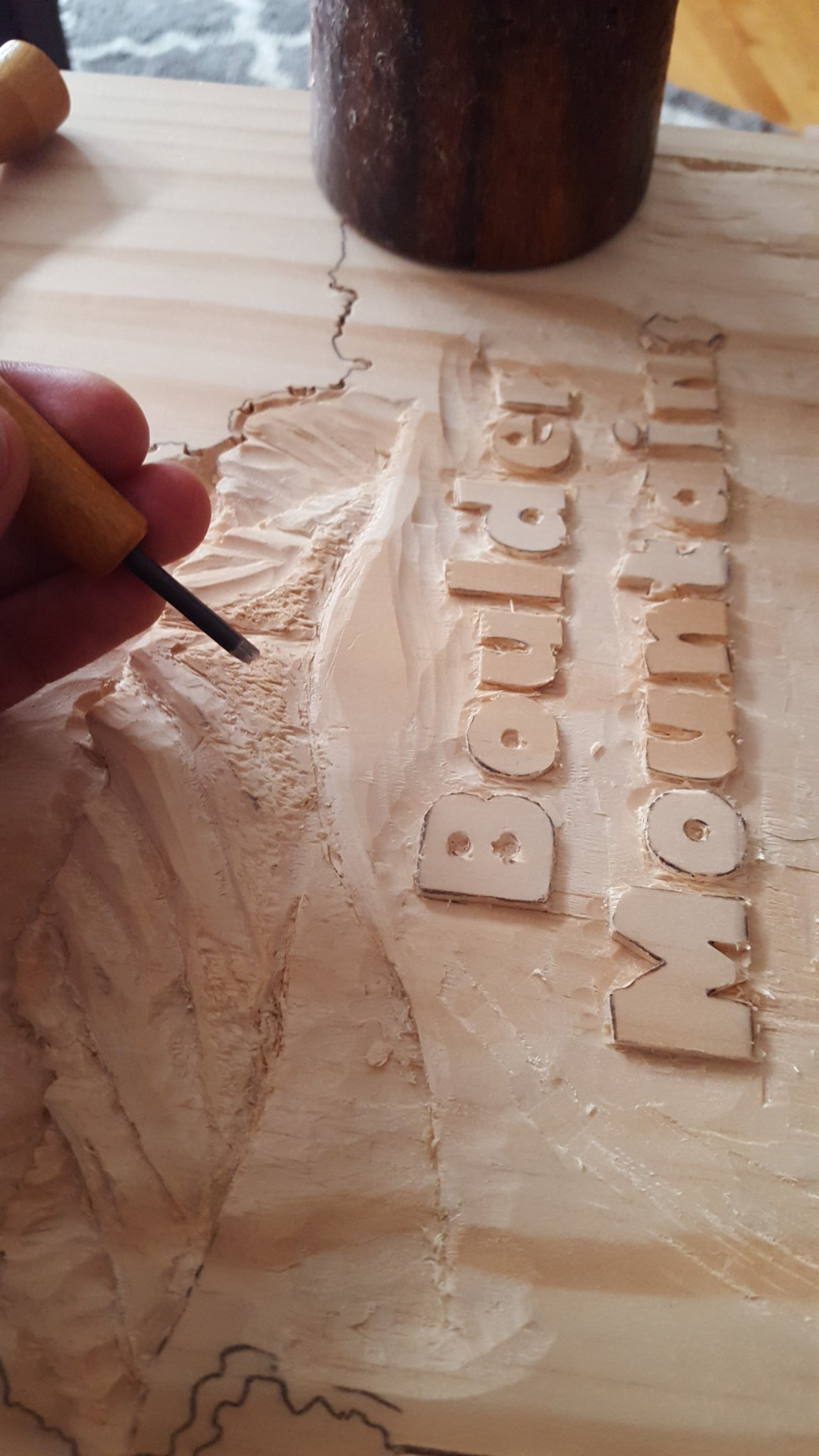 Carving an outdoor sign carving magazine